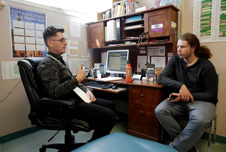 Department of Public Health nurse practitioner Adam Leonard talks with Teddy Watkins, 22, during a check-up appointment at Huckleberry House. Photo: Lea Suzuki, The Chronicle