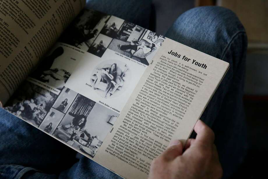 Doug Styles, executive director of Huckleberry Youth Programs, looks over an annual report from 1973 at Huckleberry House. Photo: Lea Suzuki, The Chronicle