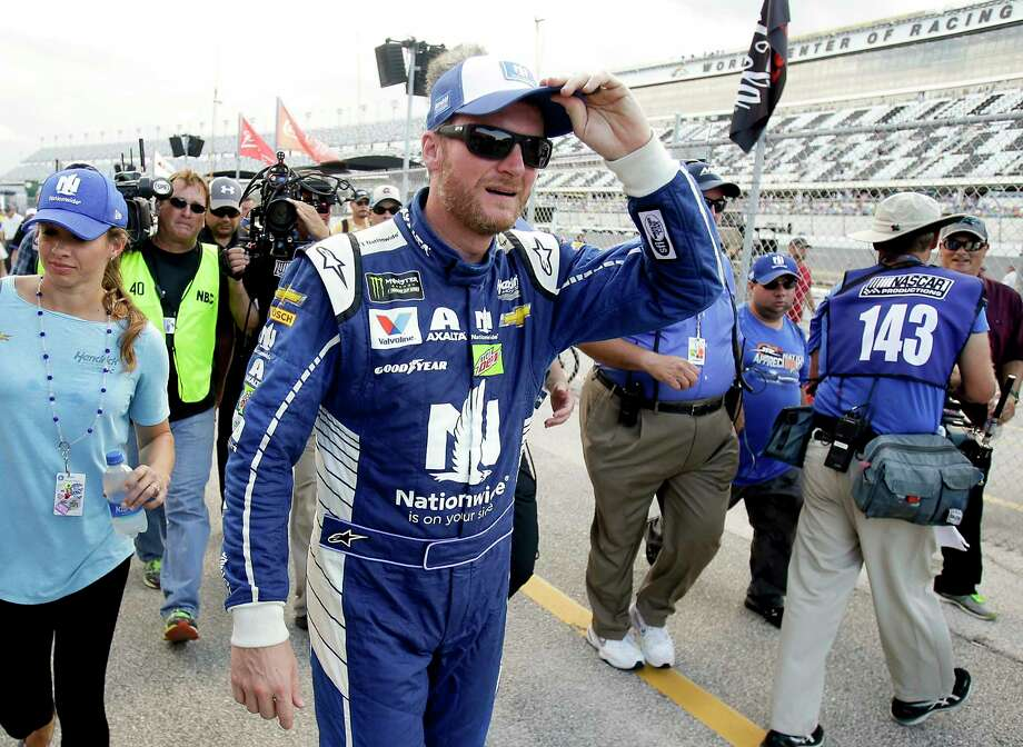 Dale Earnhardt Jr. walks back to the garage area after he won the pole position while qualifying for a NASCAR cup auto race at Daytona International Speedway, Friday, June 30, 2017, in Daytona Beach, Fla. (AP Photo/John Raoux) Photo: John Raoux, STF / Copyright 2017 The Associated Press. All rights reserved.