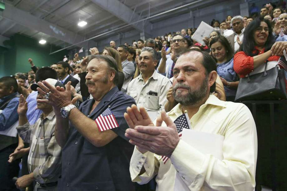 Juan Leal (right) of San Antonio joins the celebration in 2017 after 1,000 new Americans are sworn in during a ceremony in Austin. A reader says we are all Americans regardless of where our ancestors were born. Photo: Tom Reel /San Antonio Express-News / 2017 SAN ANTONIO EXPRESS-NEWS