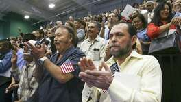 Juan Leal (right) of San Antonio joins the celebration in 2017 after 1,000 new Americans are sworn in during a ceremony in Austin. A reader says we are all Americans regardless of where our ancestors were born.