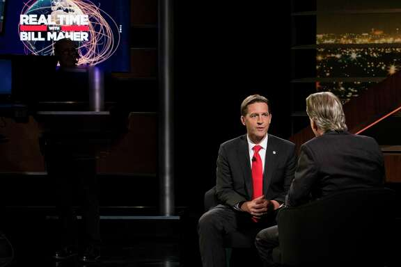 """RETRANSMISSION TO CORRECT BILL MAHER IS ON RIGHT -  In this photo provided by HBO, Bill Maher, right, speaks with Sen. Ben Sasse, R-Neb, during a segment of his """"Real Time with Bill Maher,"""" Friday, June 2, 2017. Maher is facing criticism for his use of a racial slur during a discussion with the Republican senator on his HBO talk show Friday night. (Janet Van Ham/HBO via AP)"""