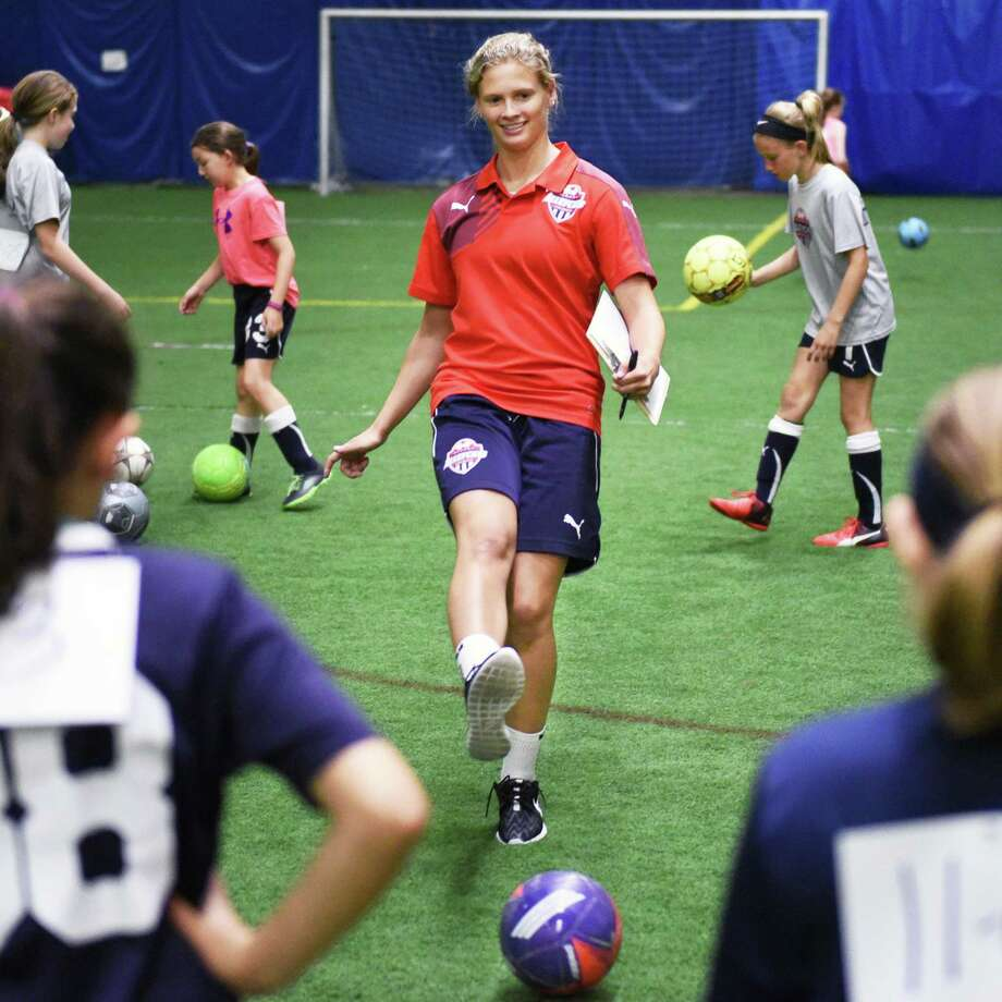 Saint Rose soccer's Morgan Burchhardt coaches kids in the Albany AlleyCat soccer summer program while rehabbing an ACL injury Tuesday June 20, 2017 in Colonie, NY.  (John Carl D'Annibale / Times Union) Photo: John Carl D'Annibale / 20040812A