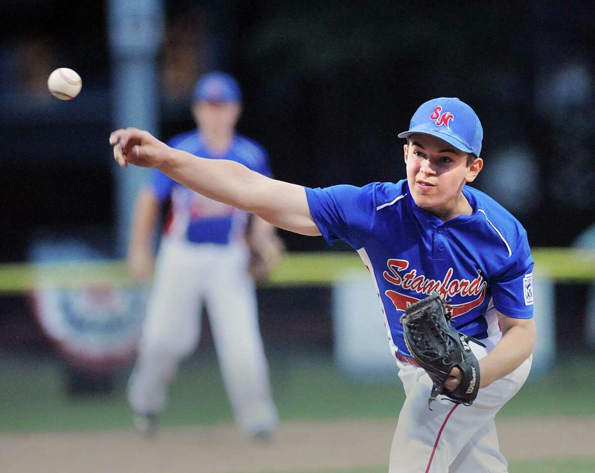 Stamford North pitcher Mike Iorfino throws during the Little League District 1 baseball game against Weston Friday night at the Springdale Little League Field in Stamford.