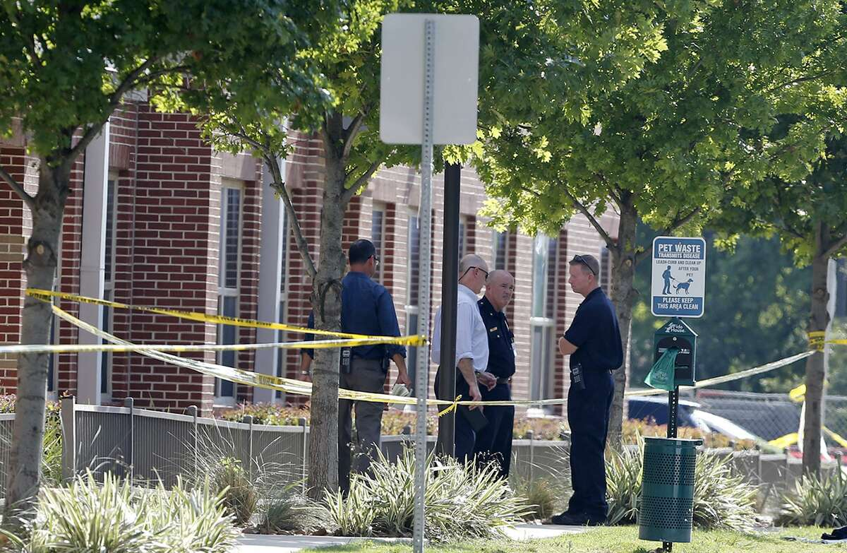 Police officers secure the scene of an officer-involved shooting near San Antonio College Thursday June 29, 2017.