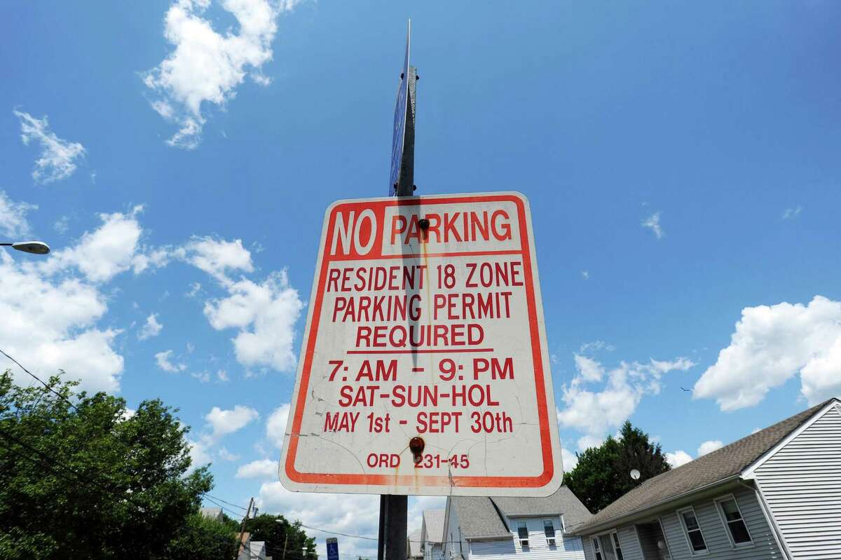 A permit parking only sign sits idly on Dean Street in the Cove neighborhood of Stamford.