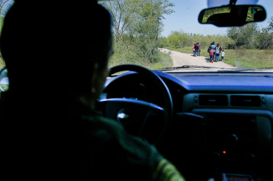 Border Patrol agent Isaac Villegas drives up on a group of immigrants in McAllen who just crossed into the U.S. Most are fleeing violence from El Salvador, Honduras and Guatemala. Photo: Michael Ciaglo, Staff / © 2016  Houston Chronicle
