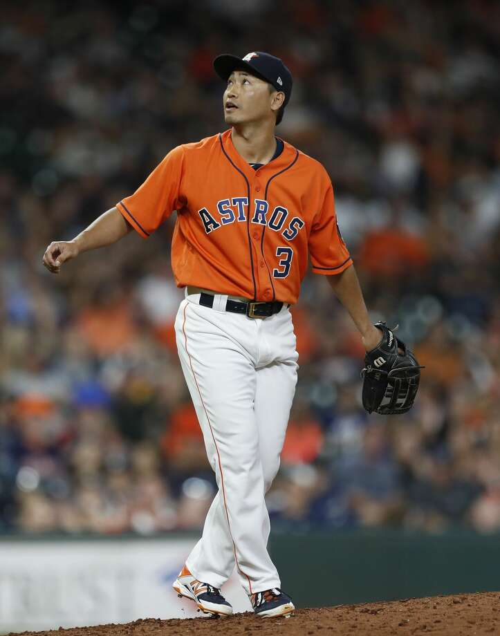 Houston Astros left fielder Norichika Aoki (3) pitches in relief during the ninth inning of an MLB baseball game at Minute Maid Park, Friday, June, 30, 2017. ( Karen Warren / Houston Chronicle ) Photo: Karen Warren/Houston Chronicle