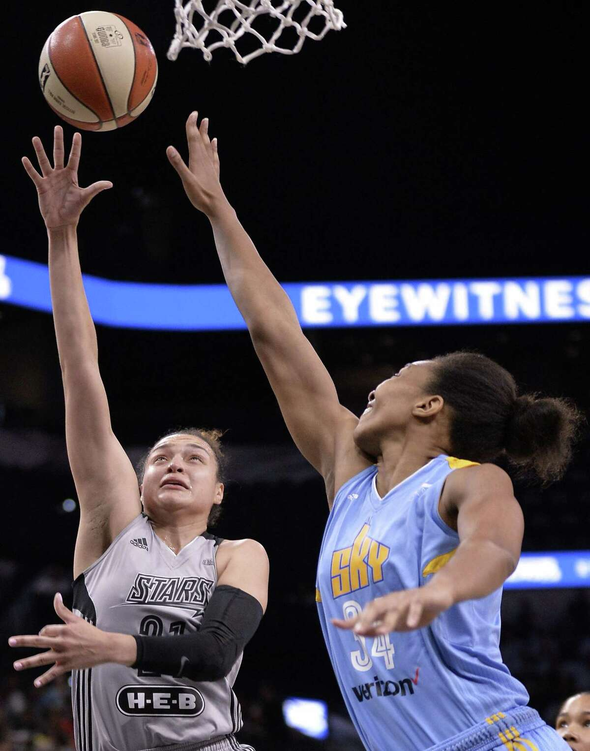 San Antonio Stars' Kayla McBride, left, shoots against Chicago Sky's Imani Boyette during the first half of a WNBA basketball game, Friday, June 30, 2017, in San Antonio. (Darren Abate/For the Express-News)