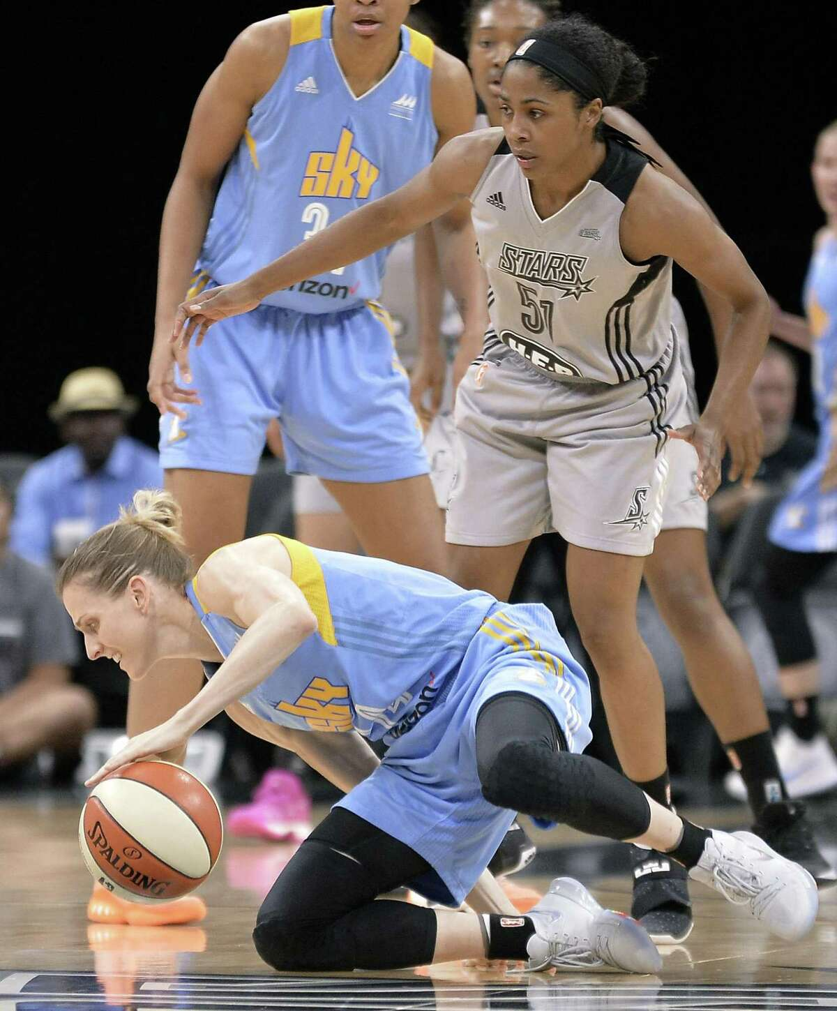 Chicago Sky's Allie Quigley, left, falls after being fouled by San Antonio Stars' Sydney Colson during the first half of a WNBA basketball game, Friday, June 30, 2017, in San Antonio. (Darren Abate/For the Express-News)