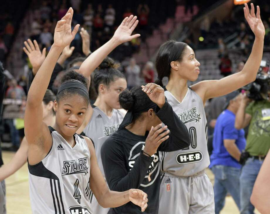 San Antonio Stars players wave to the audience after a WNBA basketball game against the Chicago Sky, Friday, June 30, 2017, in San Antonio. San Antonio won 89-82. (Darren Abate/For the Express-News) Photo: Darren Abate, FRE / Darren Abate / San Antonio Express-News