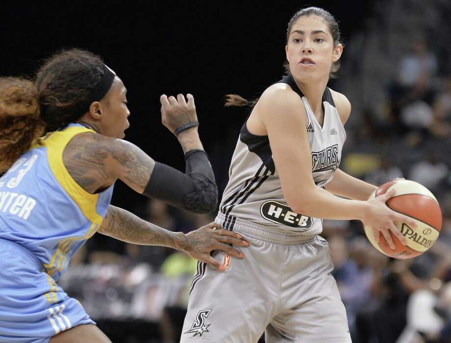 Stars' Kelsey Plum tries to pass around the Chicago Sky's Cappie Pondexter during the first half on June 30, 2017, in San Antonio. Photo: Darren Abate /Associated Press / San Antonio Express-News