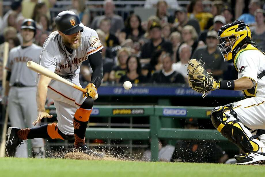 Hunter Pence spins away after being hit by a pitch with the bases loaded by Pirates reliever Jhan Marinez in the sixth. Photo: Keith Srakocic, Associated Press
