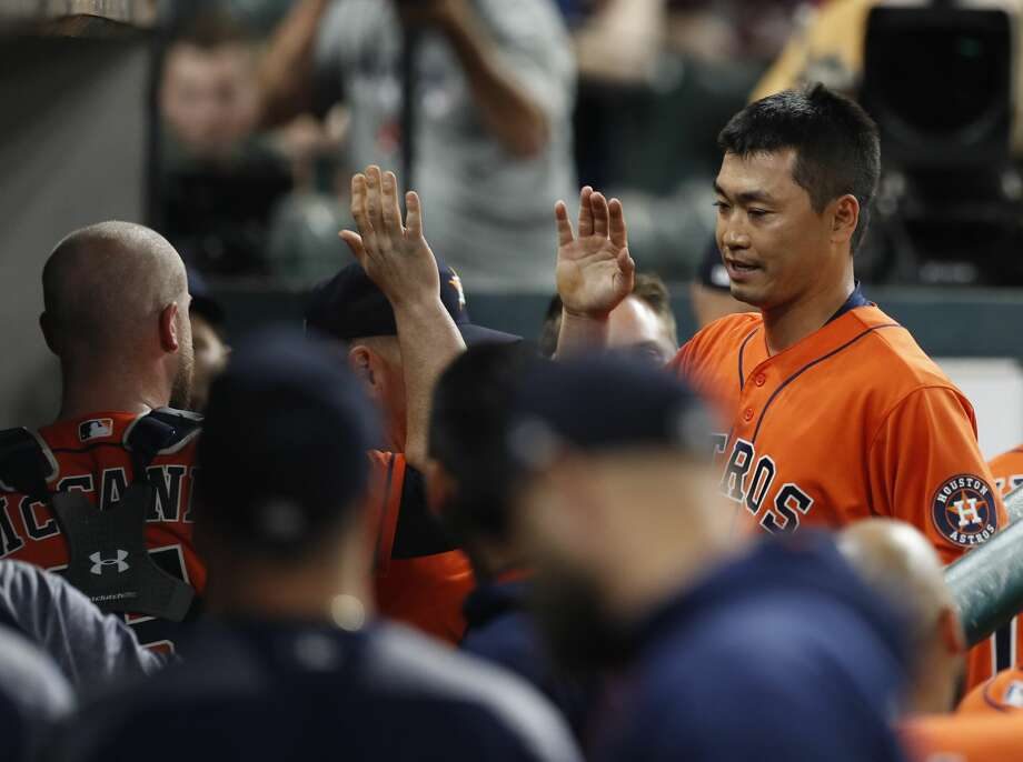 Houston Astros left fielder Norichika Aoki, who pitched in relief during the ninth inning high-fives teammates in the dugout during  an MLB baseball game at Minute Maid Park, Friday, June, 30, 2017. ( Karen Warren / Houston Chronicle ) Photo: Karen Warren/Houston Chronicle
