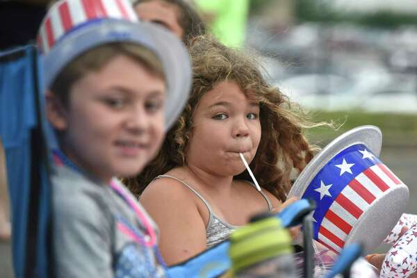 Alexis Aviles, 8, and John Gaudenzi, 9, of Danbury, wore Uncle Sam hats to the Danbury Fair mall fireworks display, Friday night, June 30, 2017, in Danbury, Conn.