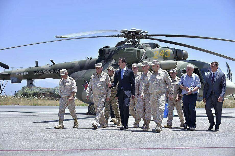 Syrian President Bashar Assad visits the Russian Hmeimim Air Base on Tuesday in Latakia province. The Trump administration is divided over whether to try to slow Assad's advances. Photo: Uncredited, Associated Press