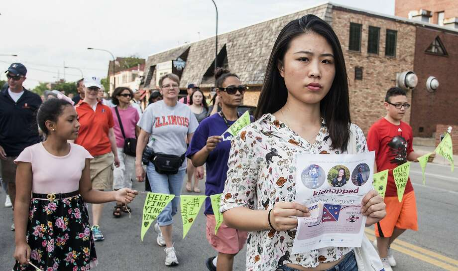 Fangqin Wan joins a walk Thursday in Urbana, Ill., to raise awareness of Yingying Zhang, a Chinese scholar who went missing. Photo: Holly Hart, Associated Press