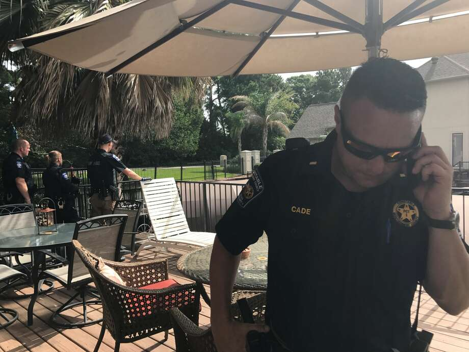 "A neighbor noticed the body while walking across the canal. ""It indicates that it has been possibly several days,"" said Precinct 1 Constable's Office Lt. Tim Cade. Photo: Meagan Ellsworth / Houston Chronicle"