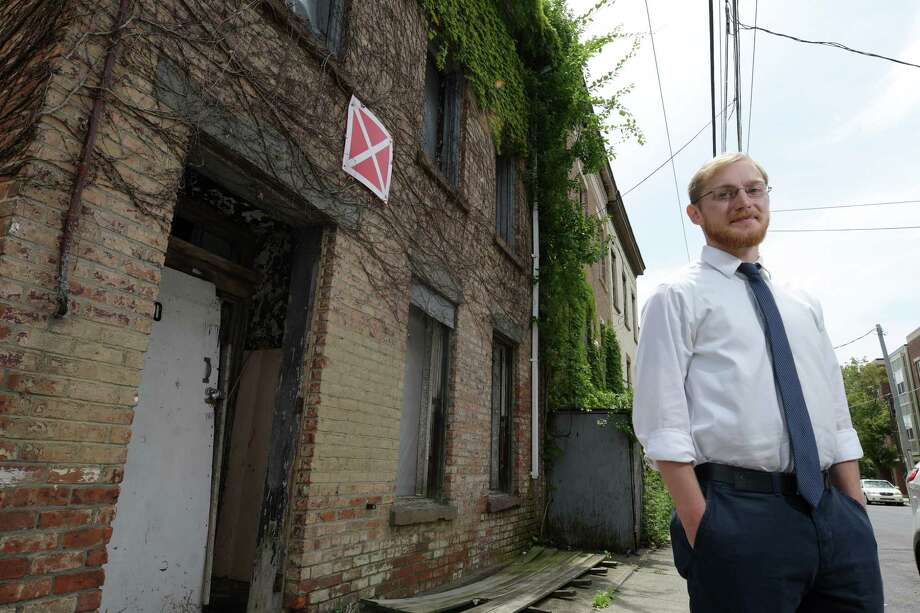 "Samuel Wells, the neighborhood stabilization coordinator for the City of Albany, poses for a photo outside of 60 Broad Street on Thursday, June 29, 2017, in Albany, N.Y.  The ""X"" on the building is placed there by the Albany Fire Department to mark a building as unsafe to enter.   (Paul Buckowski / Times Union) Photo: PAUL BUCKOWSKI, Albany Times Union / 20040924A"