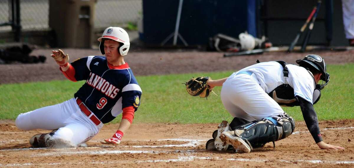 Greenwich Cannons Aaron Schur avoids the tag of Stamford Post #3 catcher Timothy Mira as he scores in the first inning during a Senior American Legion Baseball game at Cubeta Stadium on Saturday, July 1, 2017 in Stamford, Connecticut. Greenwich won 9-7.