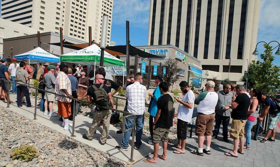 Lines formed early in the shadows of Reno's downtown casinos outside MYNT dispensary, on the first day of recreational marijuana sales. Four northern Nevada dispensaries started selling recreational marijuana to the public. Saturday, July 01, 2017. (Photo by Lance Iversen) Photo: Lance Iversen, San Francisco Chronicle