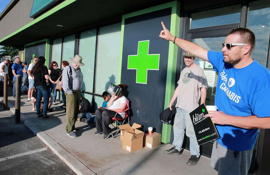 Above: Todd Weatherhead is first in line at the Dispensary in Reno, which began selling recreational marijuana Saturday. Below: Rebecca Marquez, a bud tender, holds a sample of the product. Photo: Lance Iversen, San Francisco Chronicle