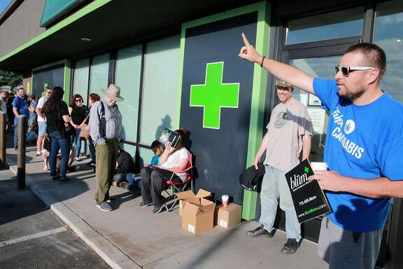 Todd Weatherhead from Reno Nevada proudly tells all new arrivals at The Dispensary, that he is first in line, to purchase recreational marijuana. Four northern Nevada dispensaries started selling recreational marijuana to the public. Saturday, July 01, 2017. (Photo by Lance Iversen)