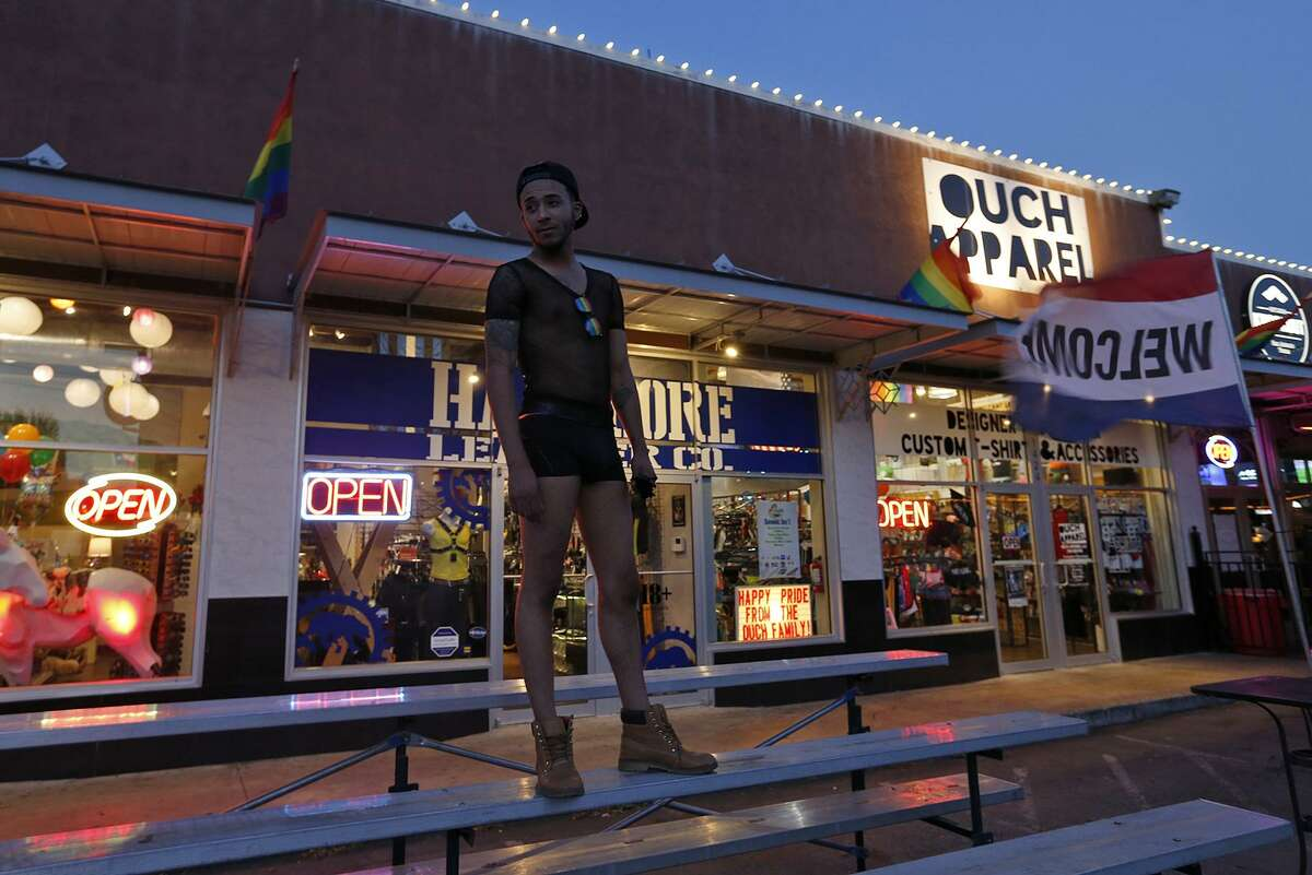 Eriq Chatman models outside Ouch Apparel at the intersection of N. Main Ave. and E. Evergreen St., Friday June 30, 2017, near the area of the officer-involved shooting that occurred Thursday June 29.