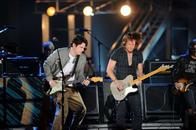 NASHVILLE, TN - JUNE 09:  John Mayer and Keith Urban performs onstage at the 2010 CMT Music Awards at the Bridgestone Arena on June 9, 2010 in Nashville, Tennessee.  (Photo by Jason Merritt/Getty Images) *** Local Caption *** John Mayer;Keith Urban Photo: Jason Merritt, Getty Images / 2010 Getty Images
