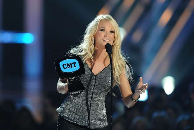 NASHVILLE, TN - JUNE 09:  Singer Carrie Underwood accepts the award for Video of the Year at the 2010 CMT Music Awards at the Bridgestone Arena on June 9, 2010 in Nashville, Tennessee.  (Photo by Jason Merritt/Getty Images) *** Local Caption *** Carrie Underwood Photo: Jason Merritt, Getty Images / 2010 Getty Images