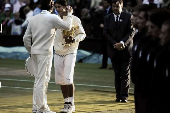 Players congratulate each other during the trophy ceremony of the 2008 Wimbledon Championships final between Roger Federer (SUI) and Rafael Nadal (ESP). (Photo by Leo Mason/Corbis via Getty Images)