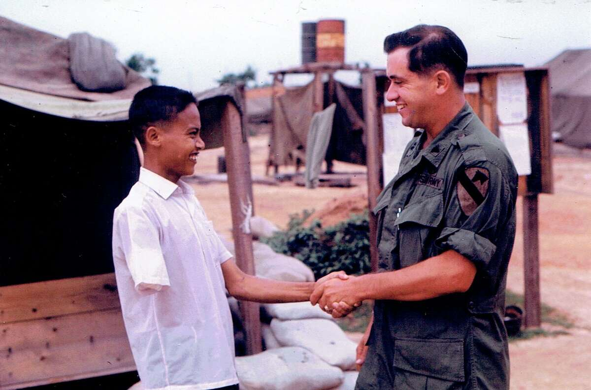 """Army surgeon Sam Axelrad in 1966 amputated the rotting arm of North Vietnamese Army soldier Nguyen Quang Hung, who was nicknamed """"Charlie."""""""
