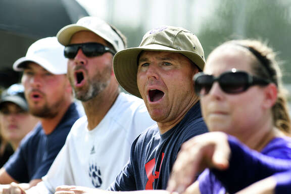 Montgomery Defensive Coordinator Scott Herman, center, and MHS Head Football Coach John Bolfing, second from left, react to a no-call during the Bear's game against Richmond Foster in their Division I Championship Bracket matchup at the Adidas State 7on7 Championships held at Veteran's Park in College Station on Saturday, July 1, 2017. (Photo by Jerry Baker/Freelance)