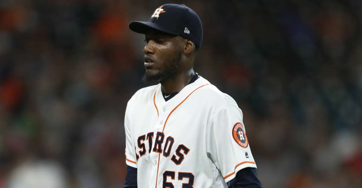 Houston Astros starting pitcher David Paulino (63) walks back to the dugout after striking out Oakland Athletics Bruce Maxwell during the second inning of an MLB baseball game at Minute Maid Park, Wednesday, June, 28, 2017. ( Karen Warren / Houston Chronicle )