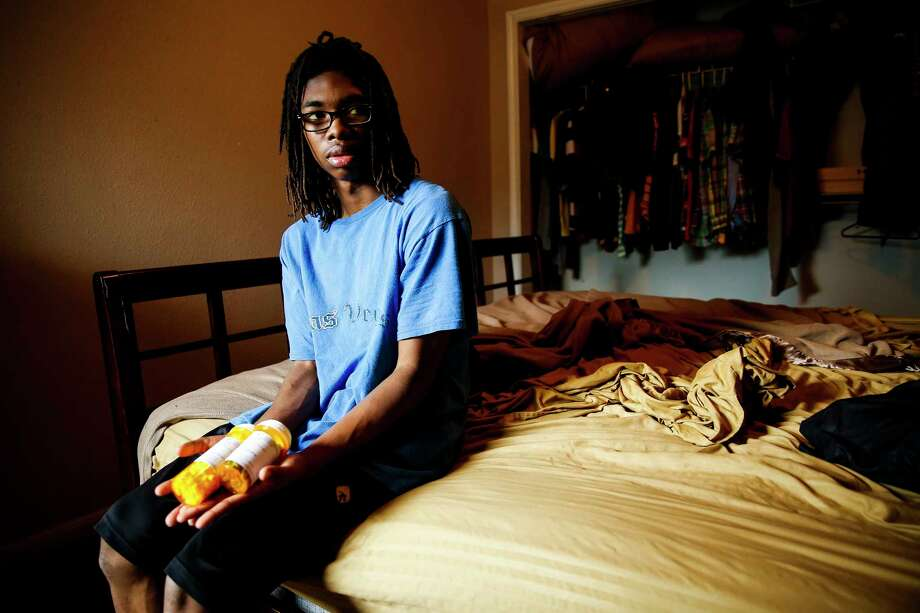 Rashad Jones goes to Texas Children's Hospital every four weeks for a blood transfusion to treat his sickle cell anemia. From ages 2 to 5, he suffered repeated strokes that have damaged his brain. His mother will soon be eligible for private insurance through her job, but it's unlikely to cover all of the care the teenager needs. Photo: Michael Ciaglo, Staff / Michael Ciaglo