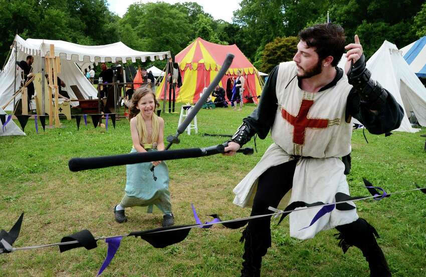 Lucian Heydt-Moorash, 6, of Brookfield, uses a padded sword to fight against knight Jacob Hawkins, of Danielson, Conn., during the Midsummer Fantasy Renaissance Faire at Warsaw Park in Ansonia, Conn. on Saturday July 1, 2017. Hawkins is part of the troupe The Knights of Gore which performed sword fights on the Field of Honor at the faire. The faire continues on Sunday July 2 from 11:00 a.m. - 6:30 p.m.
