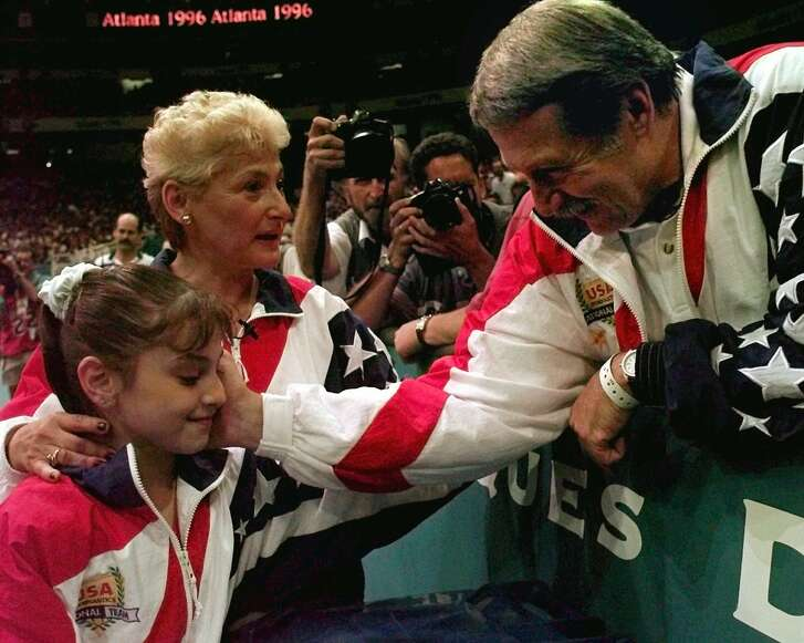 Dominique Moceanu, left, has been critical of the way Martha Karolyi, center, and Bela Karolyi, right, ran the selection process for the U.S. women's gymnastics teams over the years.