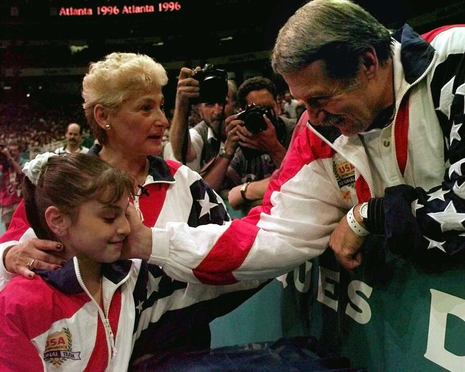 Dominique Moceanu, left, has been critical of the way Martha Karolyi, center, and Bela Karolyi, right, ran the selection process for the U.S. women's gymnastics teams over the years. Photo: AMY SANCETTA, STF / AP
