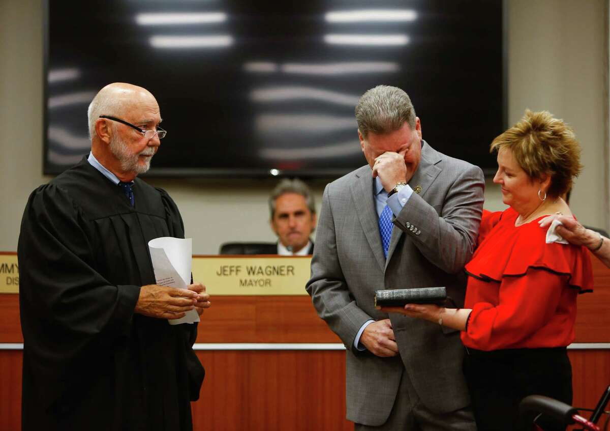 District H member Thomas Schoenbein weeps while remembering his recently deceased father as he is sworn into office during a ceremony at Pasadena City Hall, Saturday, July 1, 2017. (Annie Mulligan / Freelance)