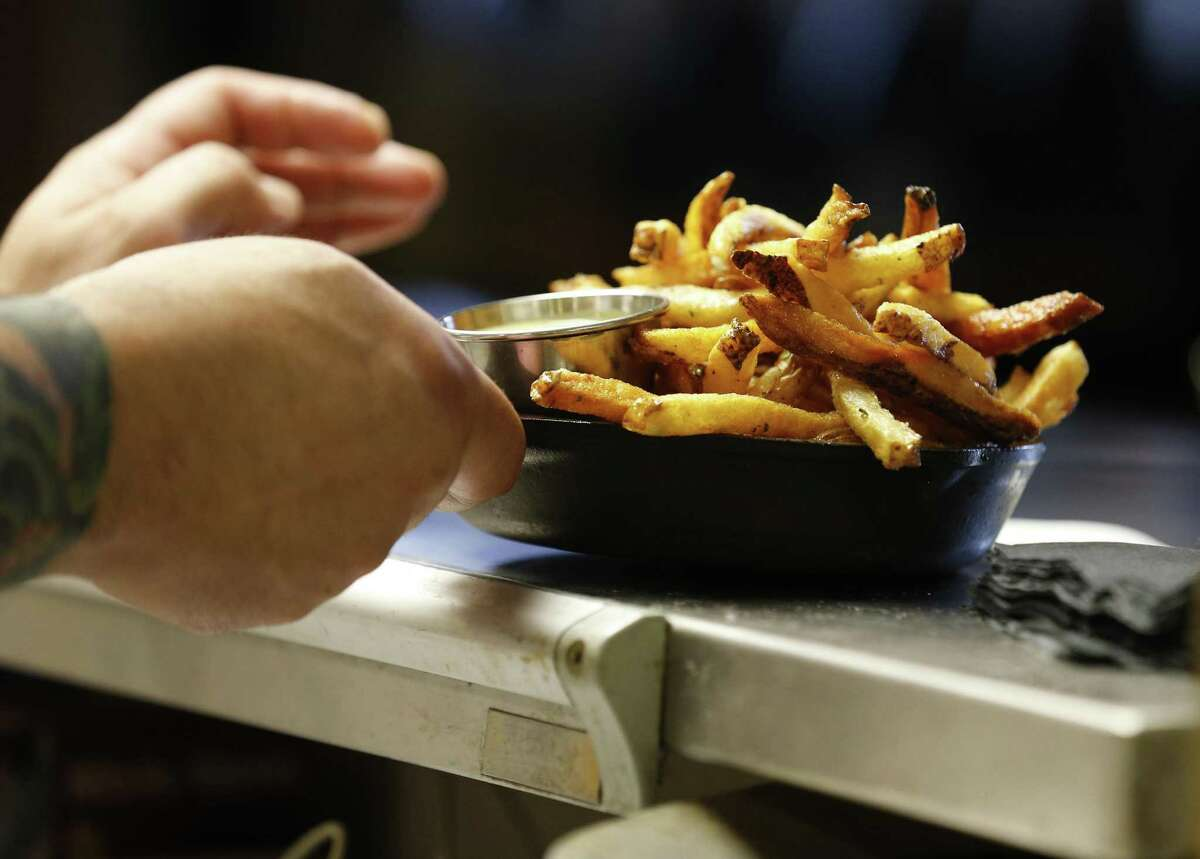 A side of truffle fries are served at 20nine Restaurant & Wine Bar.