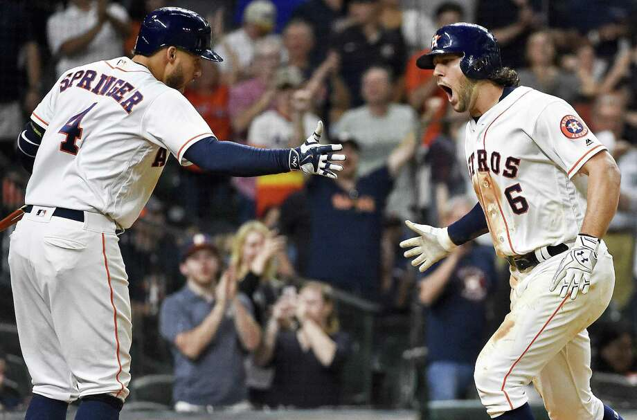 Astros' Jake Marisnick (6) celebrates his go-ahead solo home run with George Springer during the eighth inning on May 25, 2017, in Houston. Photo: Eric Christian Smith /Associated Press / FR171023 AP