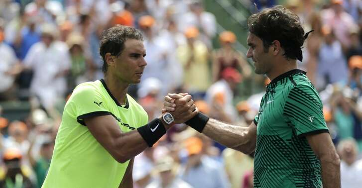 Rafael Nadal, of Spain, shakes hands with Roger Federer, of Switzerland, after the men's singles final at the Miami Open tennis tournament, Sunday, April 2, 2017, in Key Biscayne, Fla. Federer won 6-3, 6-4. (AP Photo/Lynne Sladky)