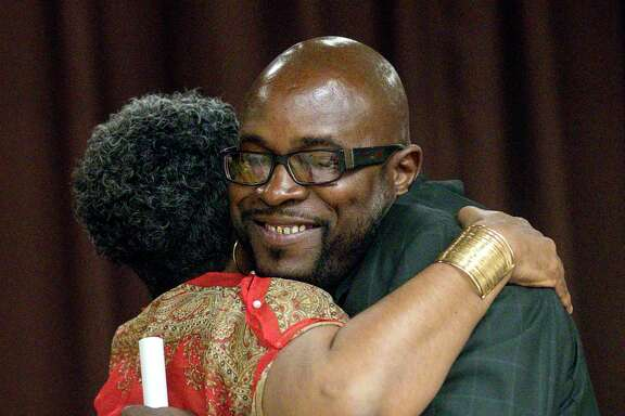 """Joseph Dowell, right, also known as """"Unc,"""" hugs Jennifer Herring, director of re-entry services at the Harris County Sheriff's Office, during a graduation ceremony for the Community Re-Entry Network Program, Thursday, May 18, 2017, in Houston. While in jail, Dowell was part of the """"Freedom Project,"""" which aims to help inmates struggling with addiction. After his release, he began working with the CRNP, and he will start a job with the City of Houston in a few weeks. ( Jon Shapley / Houston Chronicle )"""