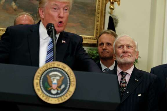 Former astronaut Buzz Aldrin listens as President Donald Trump speaks Friday before signing an executive order to establish a National Space Council in the White House.