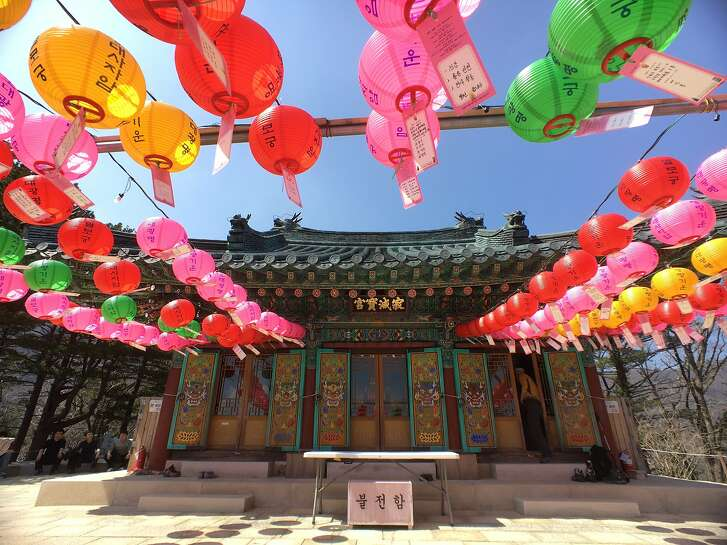 Buddha lanterns with prayer cards attached hang in front of the Jeongmyeolbogung of Woljeongsa Temple in Odaewan National Park in South Korea. The structure is said to hold a relic of the Buddha.