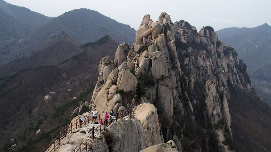 Hikers survey Ulsan Bawi, a wall of six granite peaks in Seoraksan National Park in the Gangwon region of South Korea. Photo: Spud Hilton, The Chronicle
