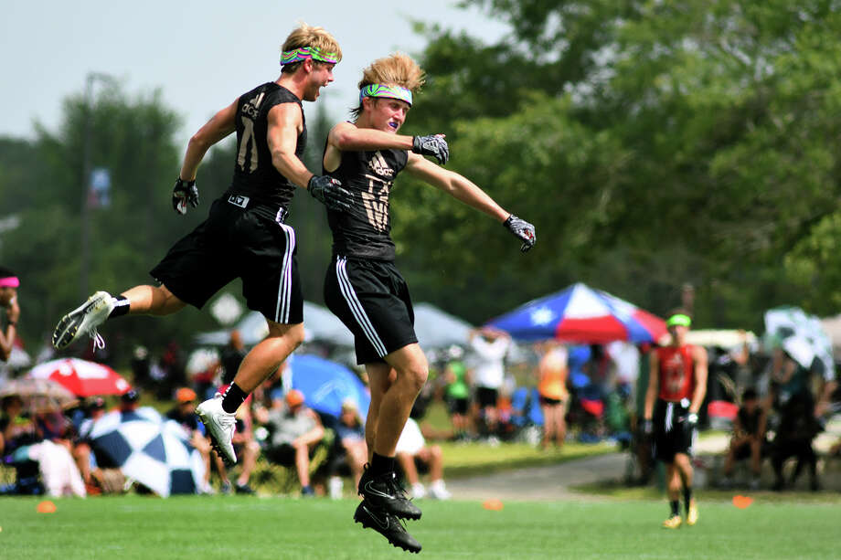 Montgomery seniors Tanner Hamilton, left, and Lucas McCaleb celebrate a defensive stop against Fort Worth All Saints during their Division I Championship Bracket matchup at the Adidas State 7on7 Championships held at Veteran's Park in College Station on Saturday, July 1, 2017. (Photo by Jerry Baker/Freelance) Photo: Jerry Baker/For The Chronicle