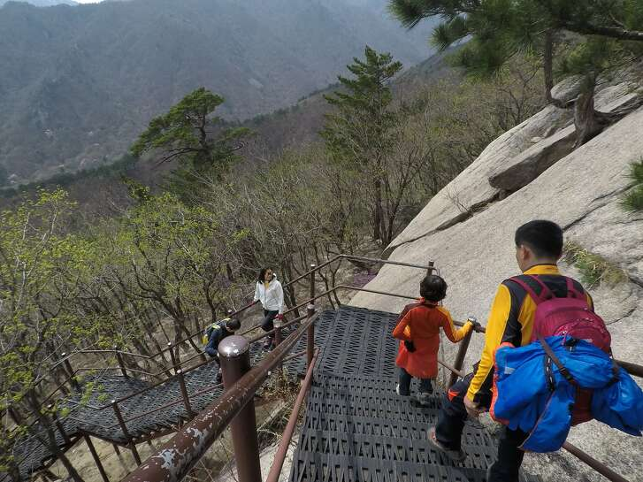 Hikers on the trail to Ulsan Bawi in Seoraksan National Park in the Gangwan region of South Korea.