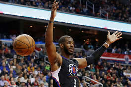 In this Dec. 28, 2015, file photo, Los Angeles Clippers guard Chris Paul reacts after dunking the ball during the first half of an NBA basketball game against the Washington Wizards, in Washington. (AP Photo/Carolyn Kaster)