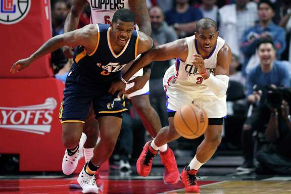 New Rockets guard Chris Paul, right and below, wants to pursue an NBA championship as intensely as he pursues a loose basketball on the court.
